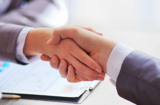 Business People Shaking Hands After Mediation